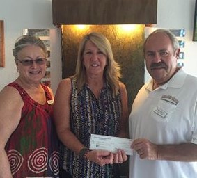 Jonny and Tom Mays presented a check to New Horizons director Terry Delia on behalf of Relics and Rods Car Club.