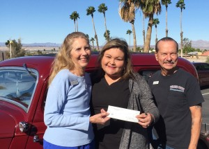 Kathy & Dick Stiller presenting a check to Dementia Connection of Havasu for $1,000.